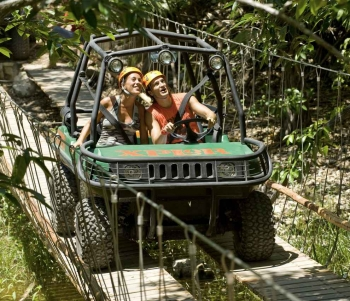 Two people riding in an amphibious vehicle.